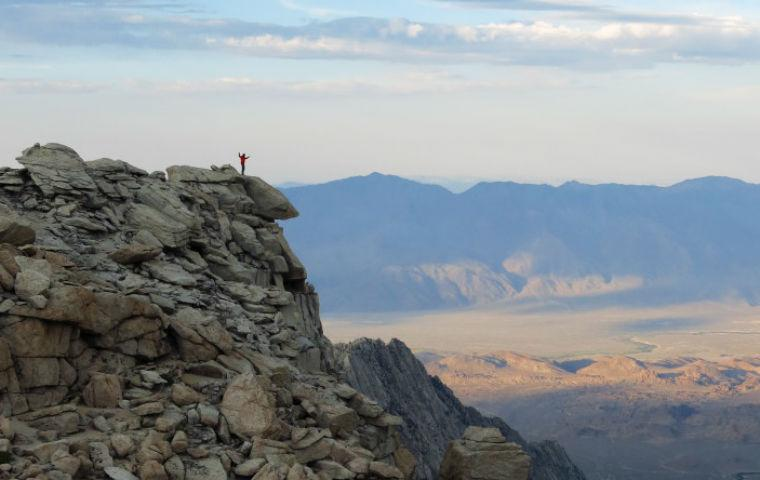 Fulbright Winner Sean Reilly atop East Sierra mountain image link to story