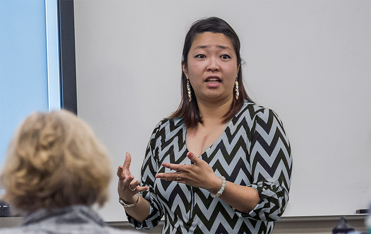 Assistant Professor Sherry Wang teaches in a classroom image link to article
