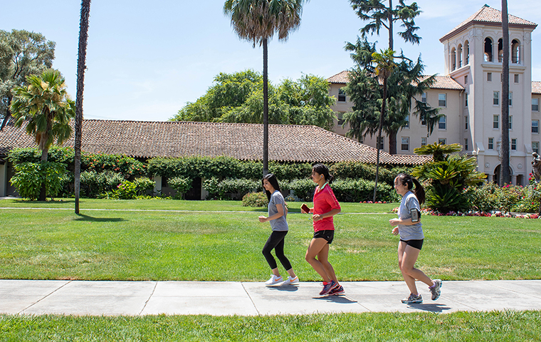 The three creators of the Solemate coaching app test it on a run across campus. Photo by Andrea Yun. image link to story