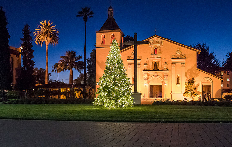 Christmas tree lit up in front of Mission Church on SCU campus