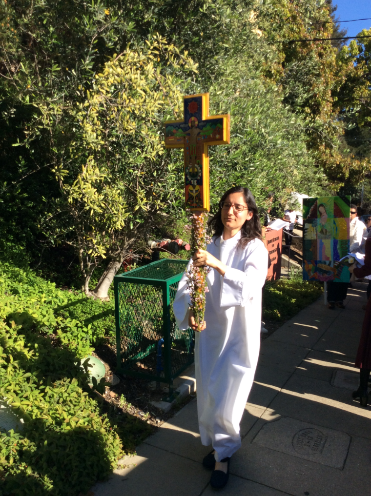 Silvana Arevalo carries processional cross for 30th Anniversary of Instituto Hispano