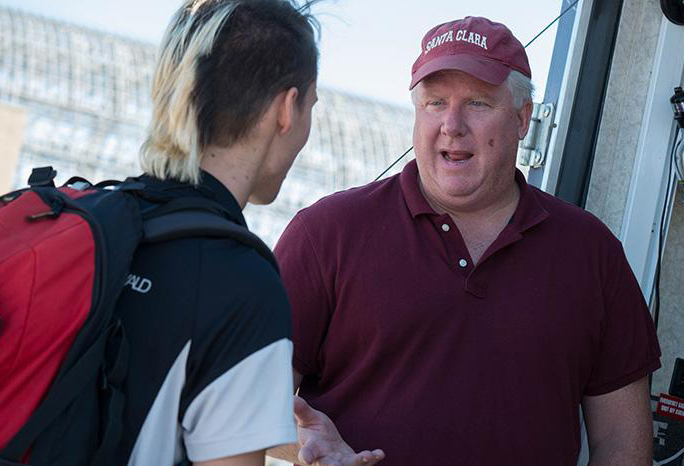 Chris Kitts speaks with a student in one of the on-campus garages