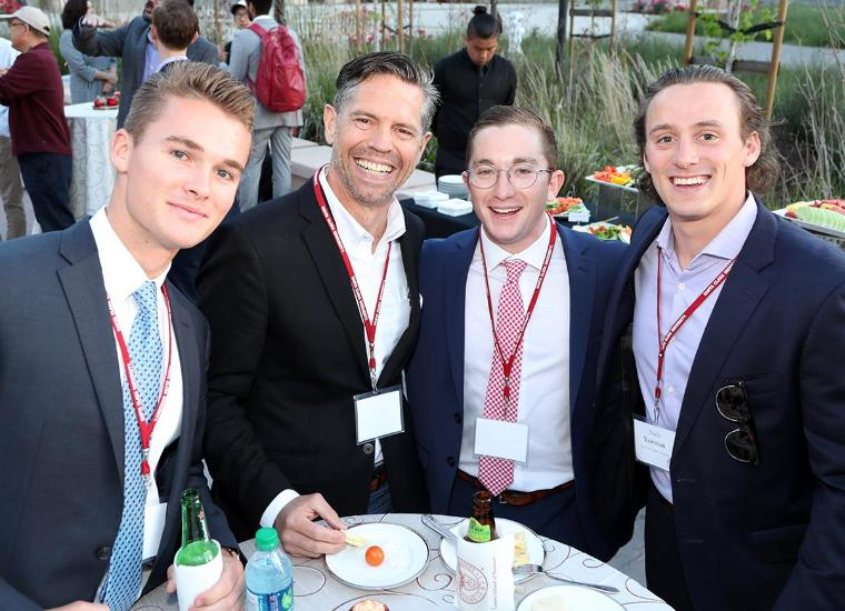 Real estate students mingling with real estate industry experts.
