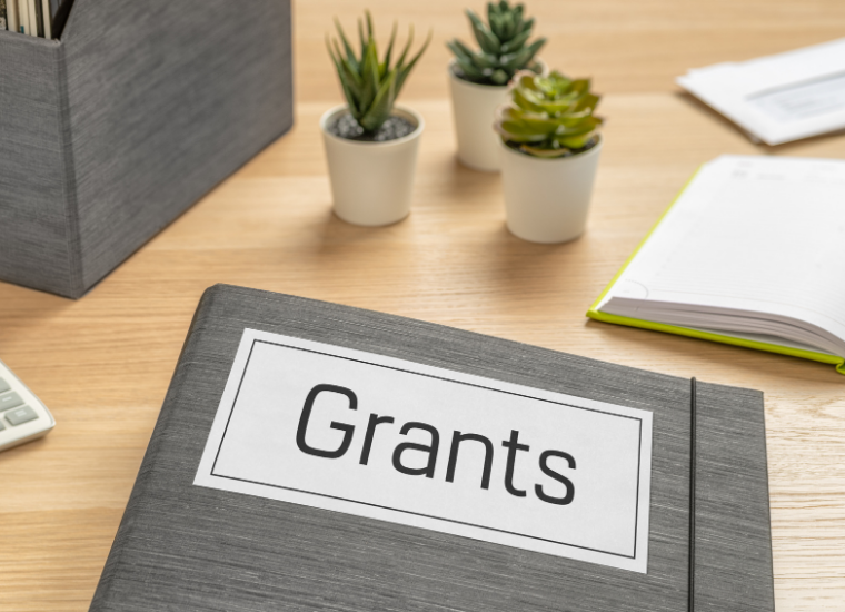 Photo of file folder with the word grants displayed image link to story