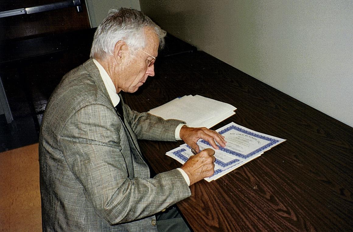 MOBI Chairman Phil Holland signs certificates of completion image link to story