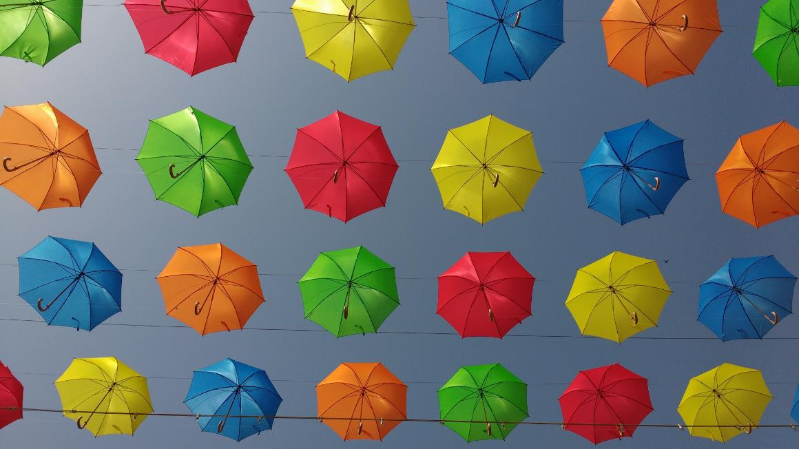 A set of umbrellas of different colors.