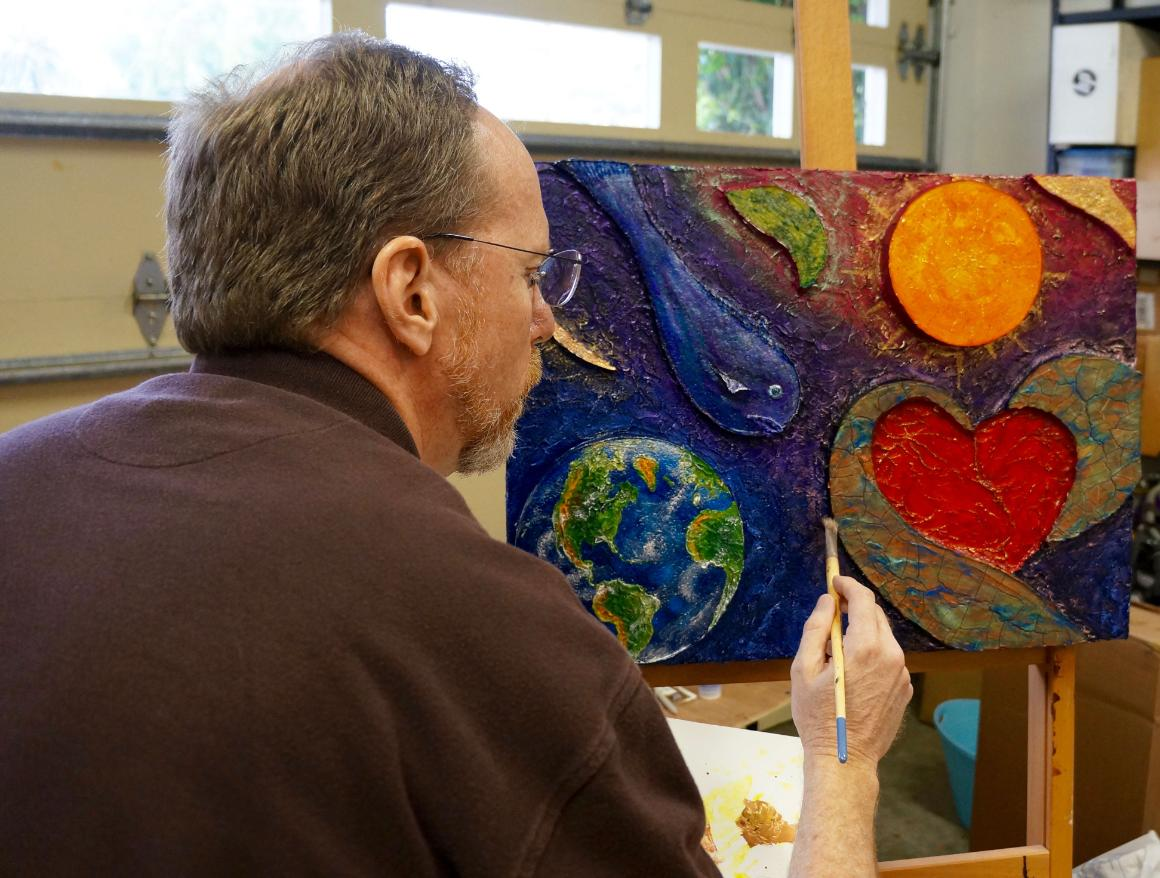 Dennis Jacobs paints in response to Laudato Si