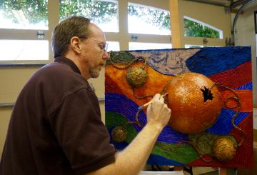 Dennis Jacobs paints a mixed media piece