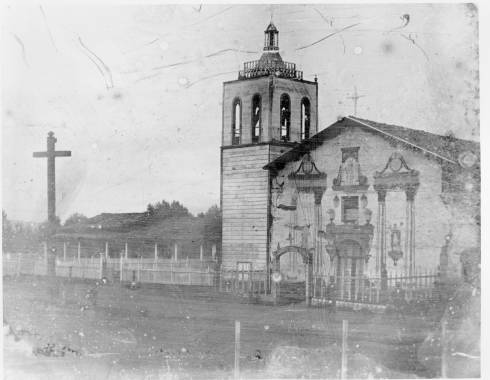 Earliest known daguerrotype photograph of the Mission in 1854. Bell tower is sheathed with planks. Facade is painted with images of St. Clare, Francis and John the Baptist.