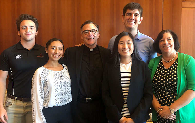 SCU president O'Brien with students
