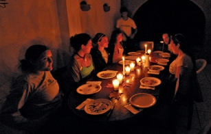 Night dinner dark with candles image link to story