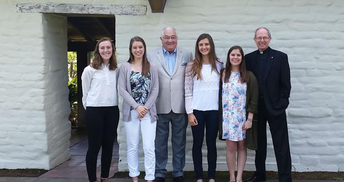 Four Robert Warren Scholars by the Adobe Wall with Robert Warren and Fr. Engh after a luncheon.