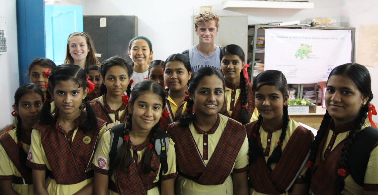 Alicia, Vanessa, and Rowan (3 SCU students) with Green Rhinos students in India image link to story