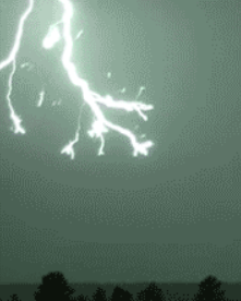 Bright lightening coming down from the top left frame of the picture, extending half way to the ground