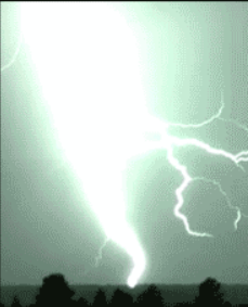 Lightning causing a bright flash and illuminating the sky