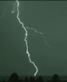 One long strand of lightning coming from the sky, touching the ground