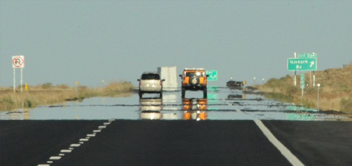 The illusion of a pool of water on the road