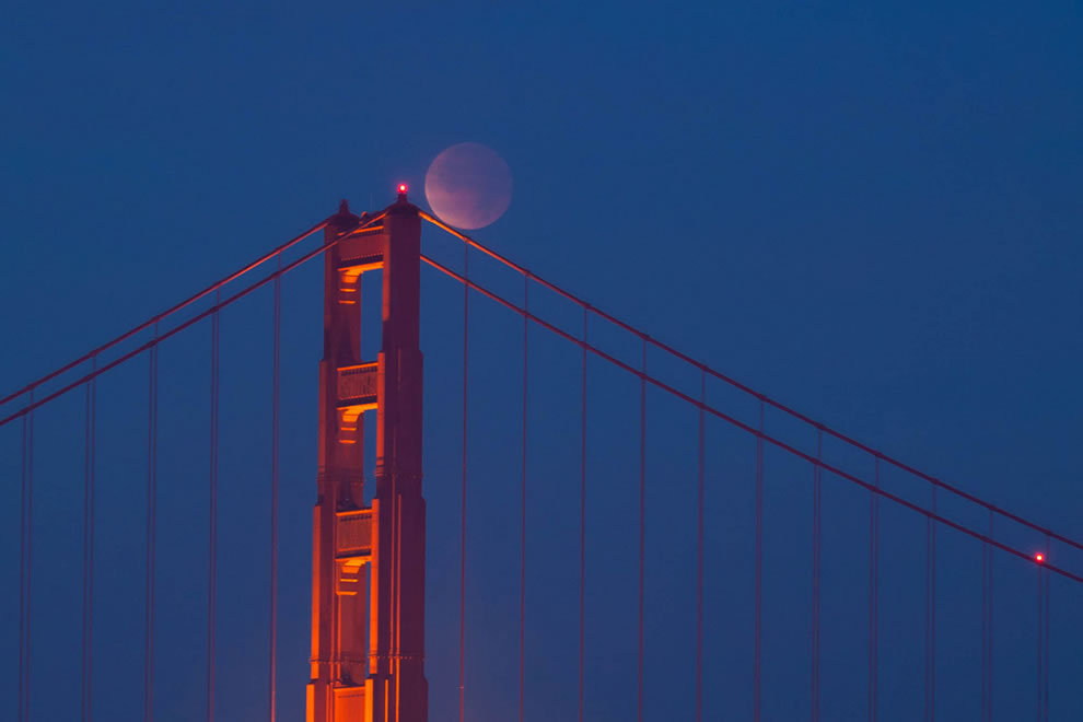 A total lunar eclipse seen over the Golden Gate Bridge is a striking image!