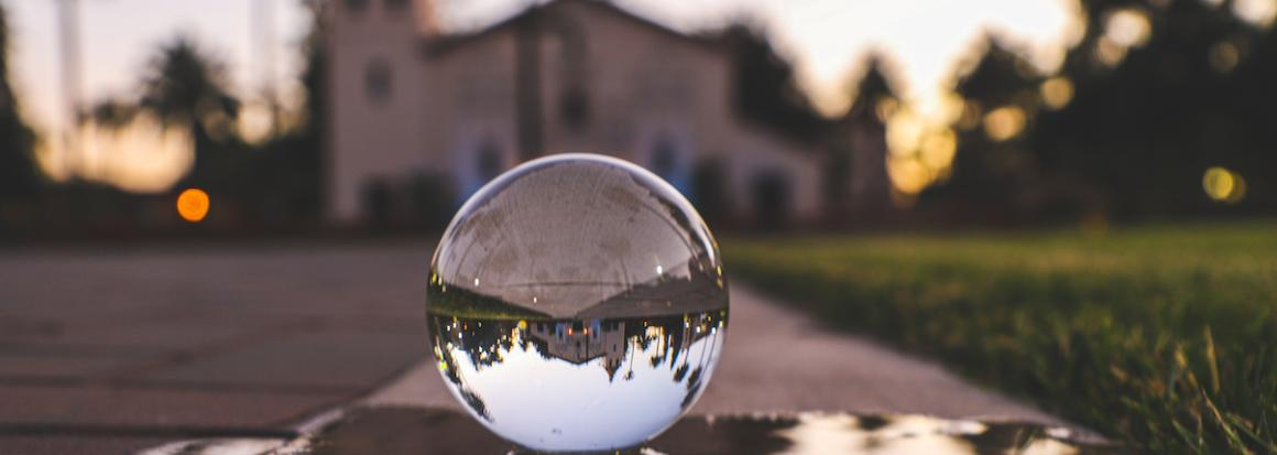 A crystal ball reflects the SCU Mission.