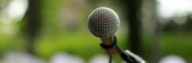 Microphone in the forefront with a blurred out background