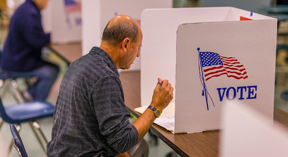 Man sits at voting booth