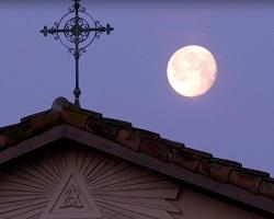 Cross on the roof of the Mission and the moon.