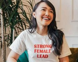 Woman wearing a t-shirt that says Strong Female Lead.
