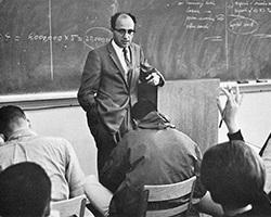 A younger Mario Belotti teaching in the classroom.