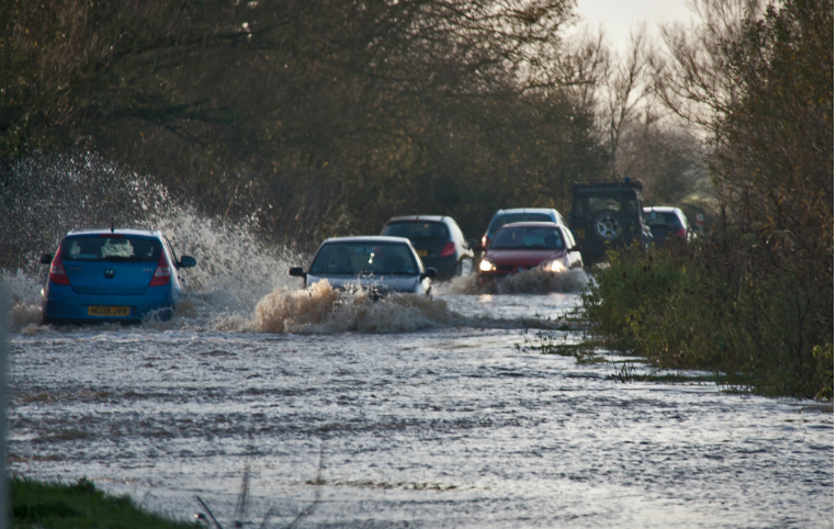 Flooded cars on roads image link to story
