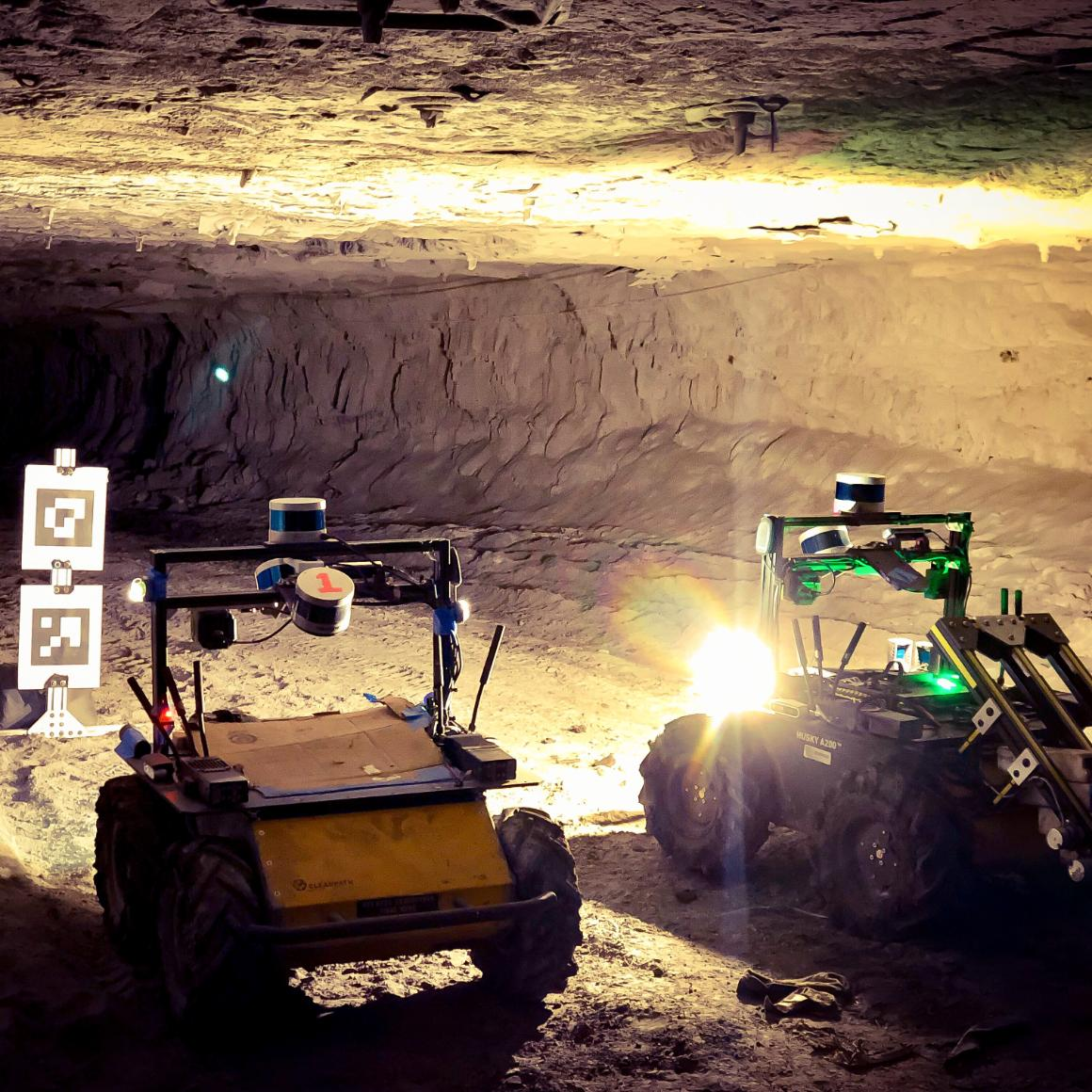 Two autonomous robots locate a target in a tunnel image link to story