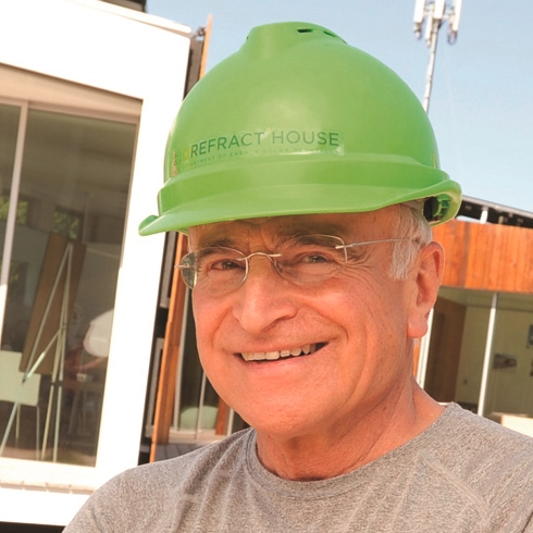 Jim Reites, S.J., on the construction site for SCU's 2009 entry in the Solar Decathlon.