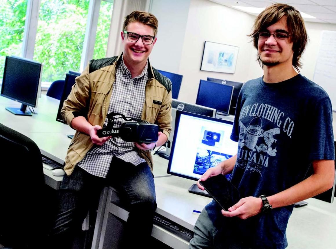 Bryce Mariano, left, and Paul Thurston show off the Oculus Rift and tablet that therapists employing their software can use to allay patients' fears.