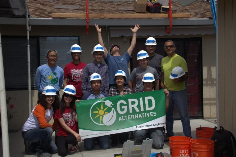SCU engineering students pose with a GRID Alternatives banner