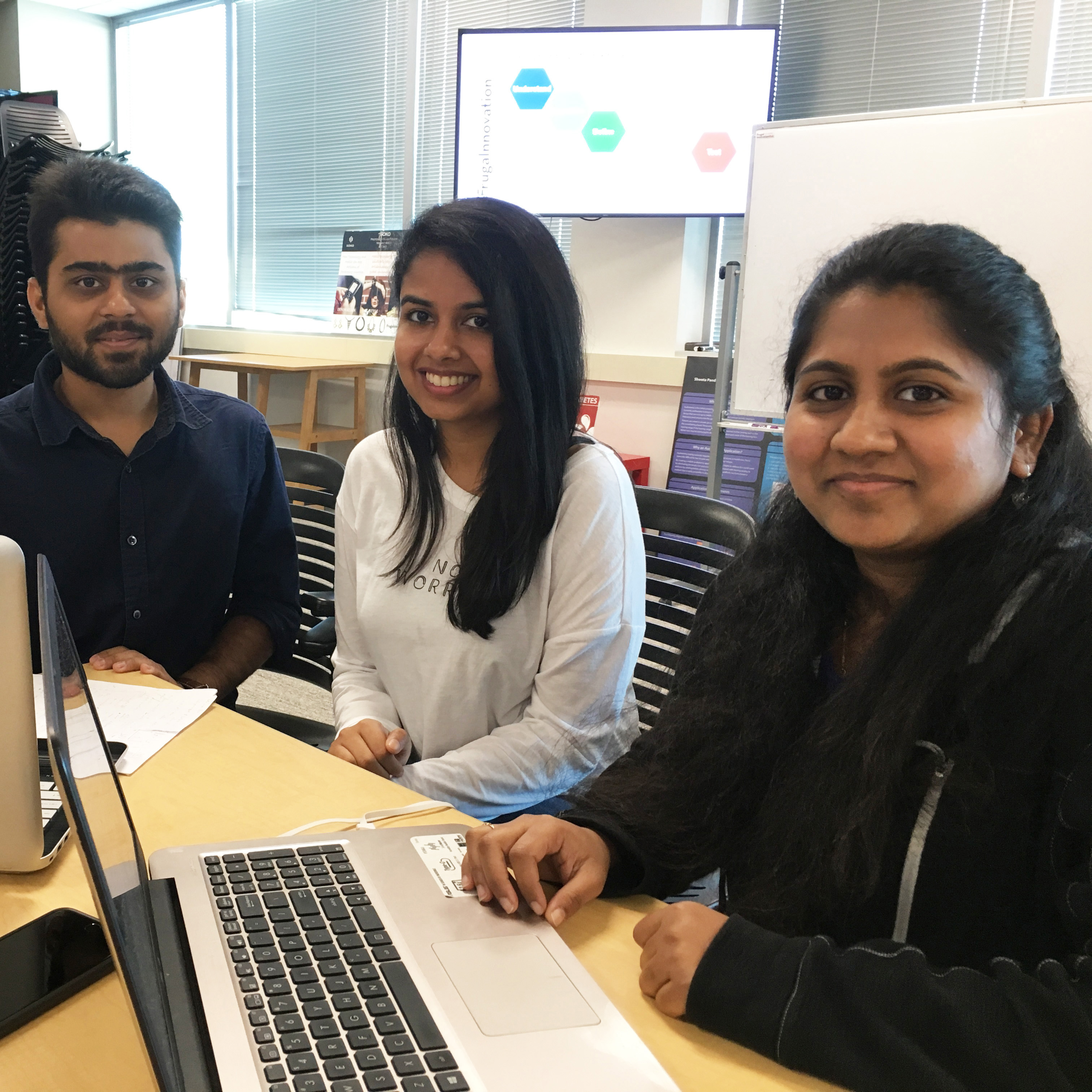 Graduate computer engineering students Grism Patel, Anjeli Kumar, and Barsa Nayak in the Frugal Innovation Hub image link to story