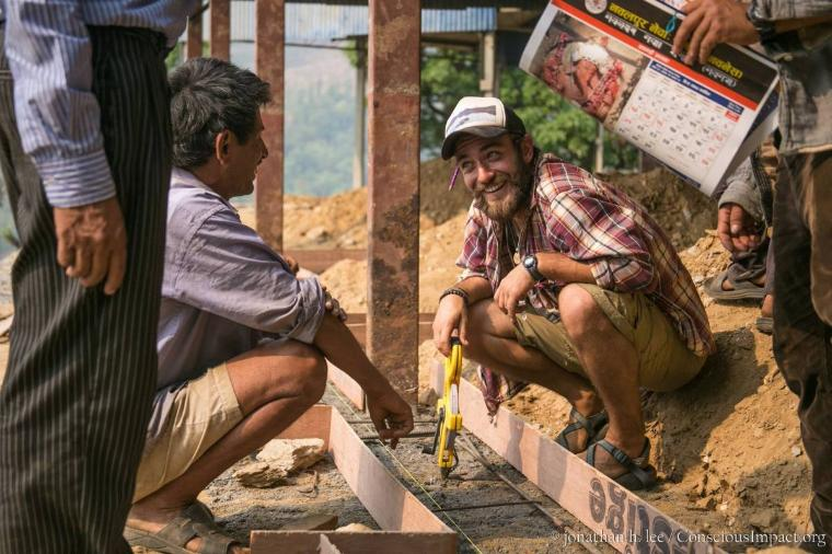 Scott Hanson '14, right, on the job in Nepal.