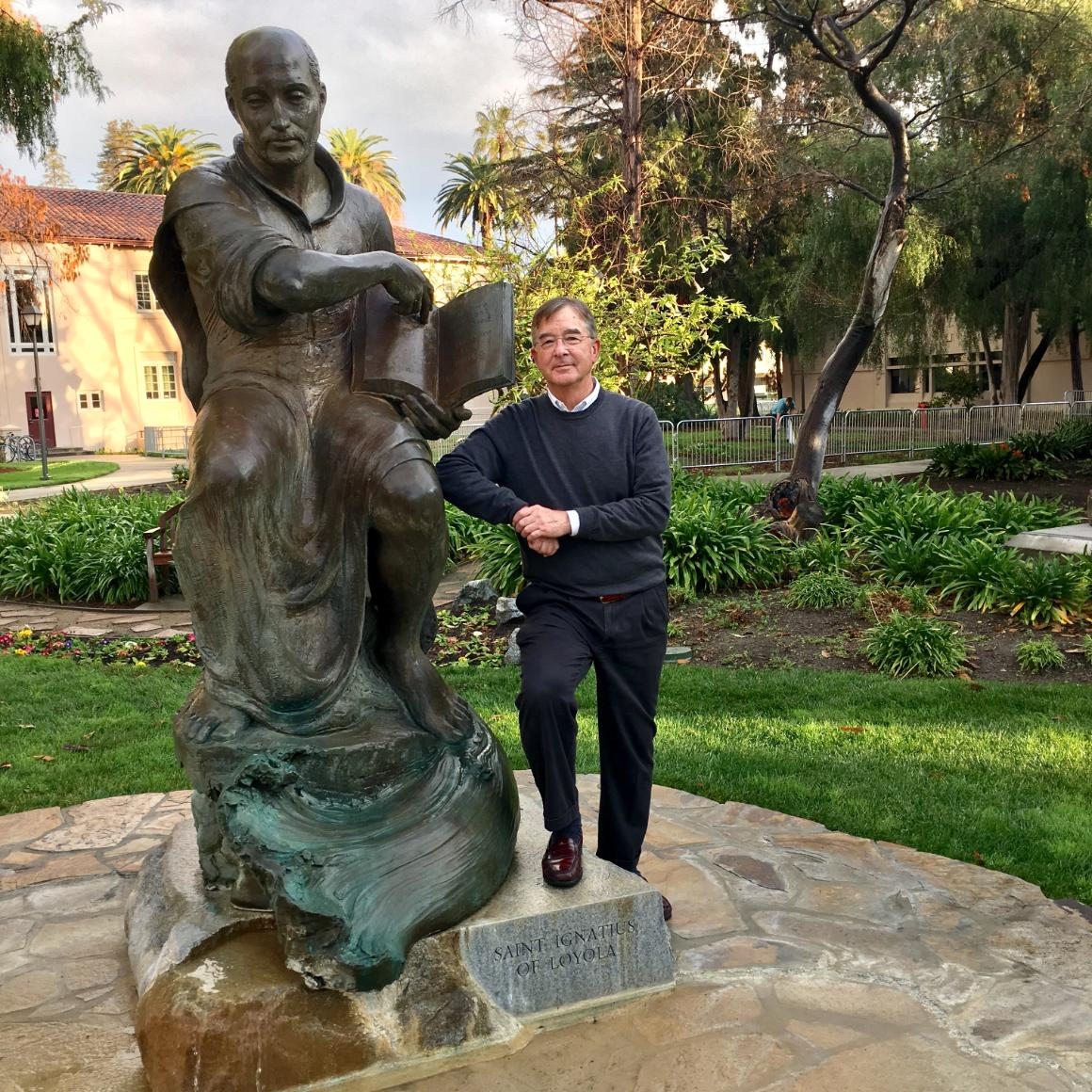 Lanny Vincent with SCU's statue of St. Ignatius image link to story