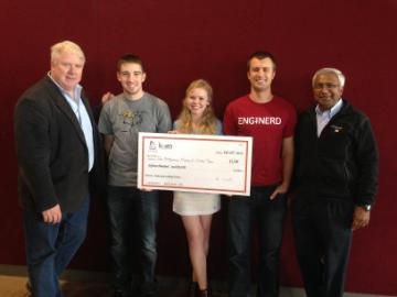Student winners holding a big check posing with Professor Christopher Kitts and Dean Godfrey Mungal