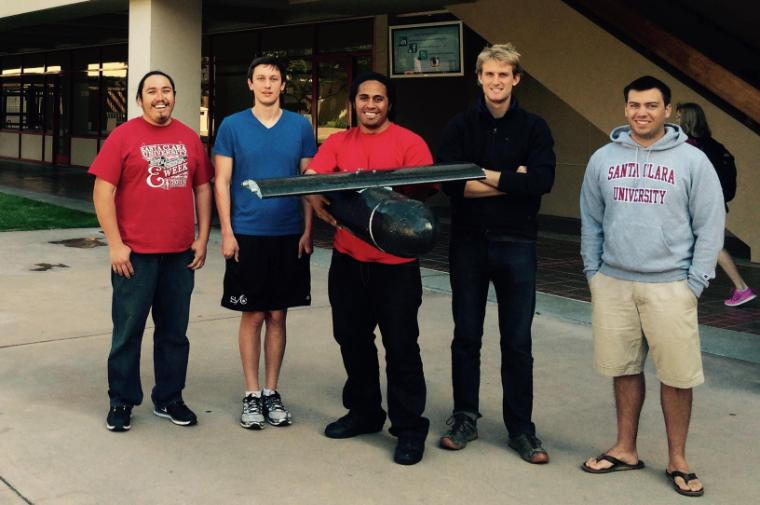 From left, Robert Llanos-Hinson, Thomas Clark, Siosiua Faleta, Micah Klaeser, and Michael Dewane with a portion of their prototype. image link to story