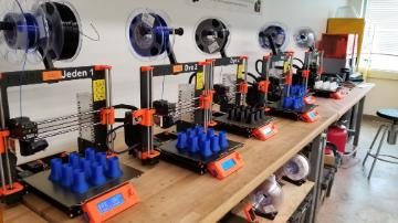 3D printers with test tube holders being printed