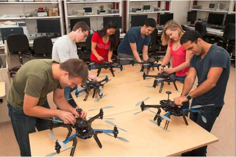 Six students working on octocopters in the Robotics Systems Laboratory