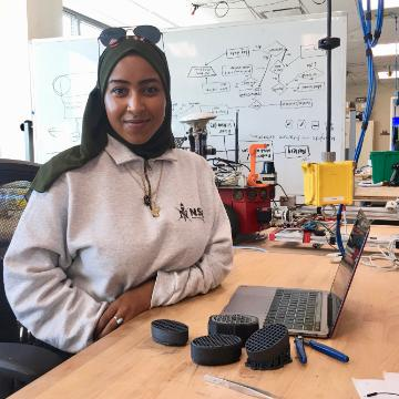 Mai Sinada in the Robotics Systems Lab with her project. image link to story