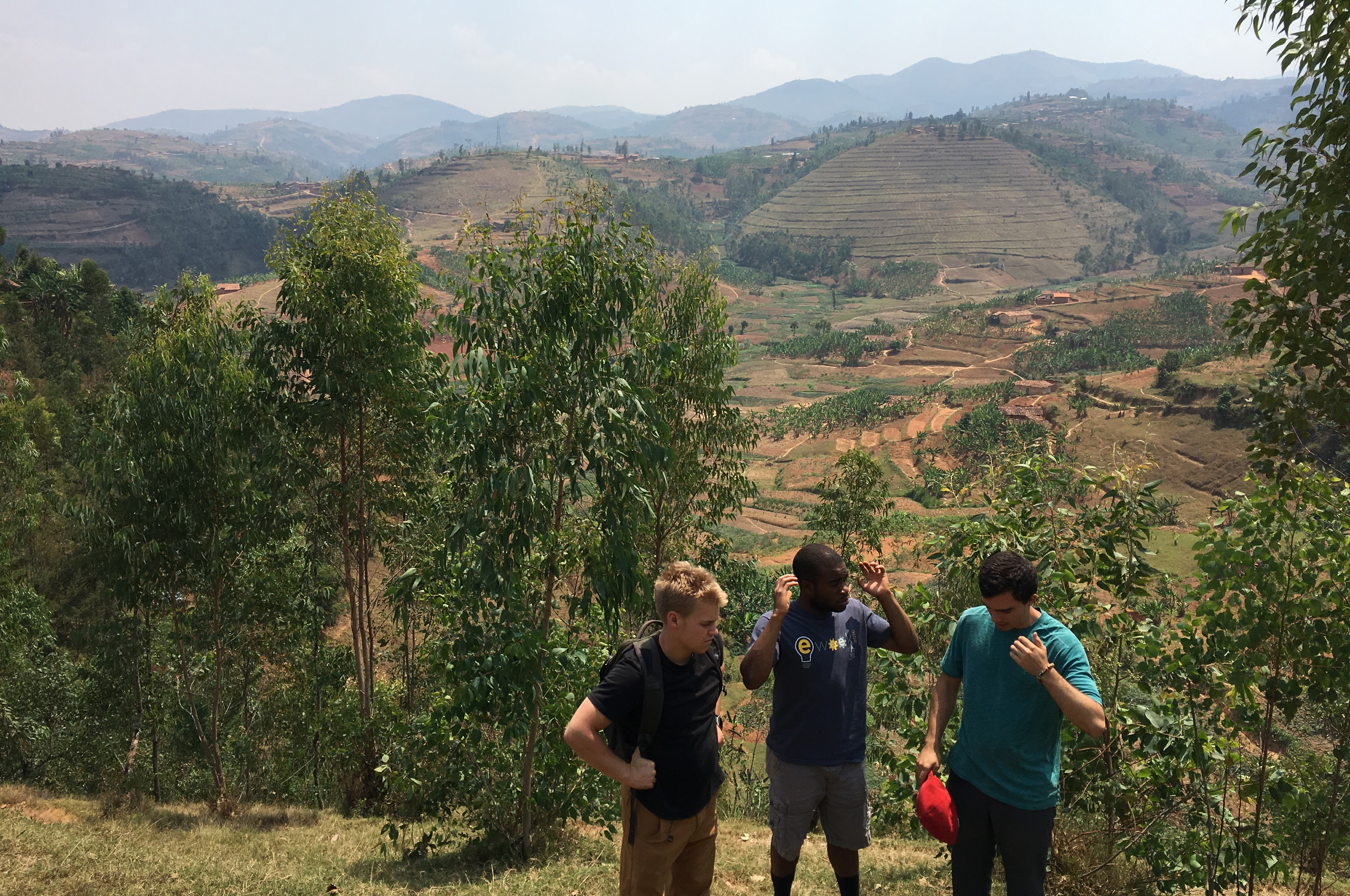 Ben, Uche, and Jon study the terrain for the future clay transport system