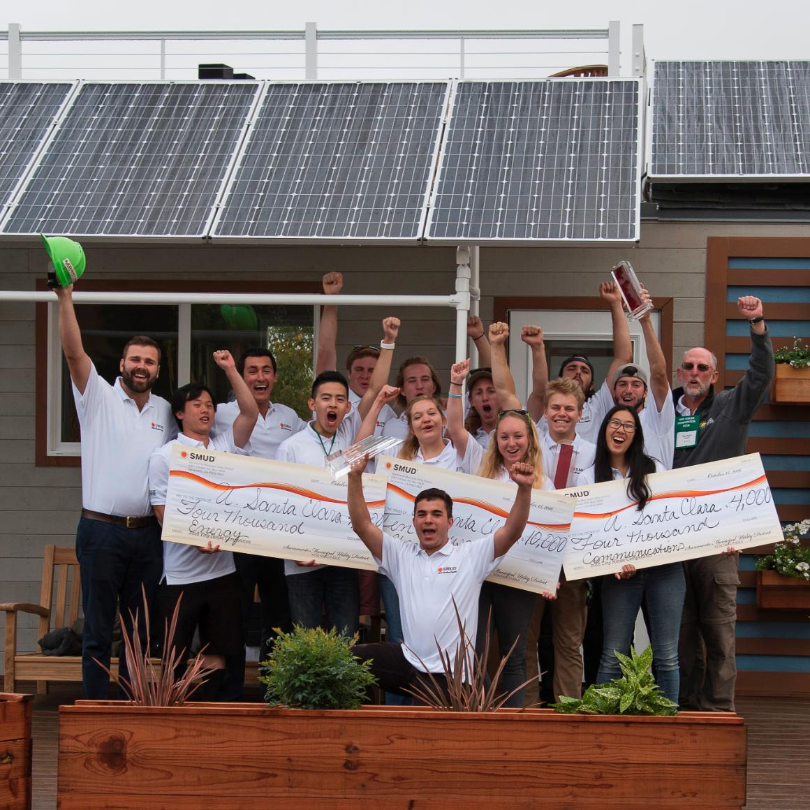 SCU's 2016 Tiny House team celebrates their victory in front of rEvolve House