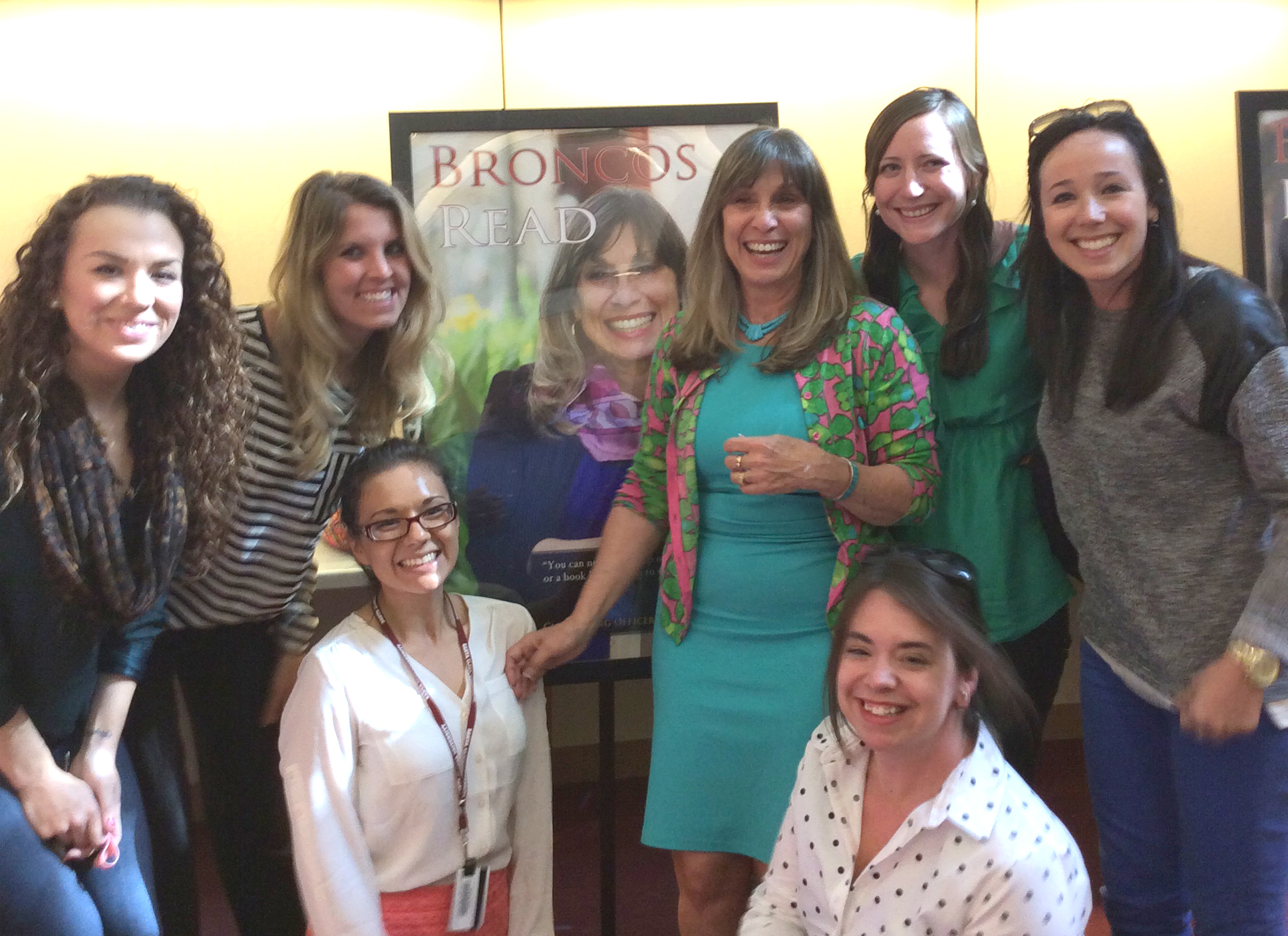 Leslie Leonetti '73 (Class Giving Officer for the Office of Development) poses with colleagues that nominated her for the 2015 Broncos Read poster.